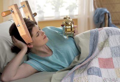 A woman experiencing headaches